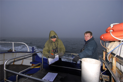 Ross still recording, Alan looking cheerful as we approach a fog bank