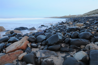 Dunstanburgh Castle and boulder beach